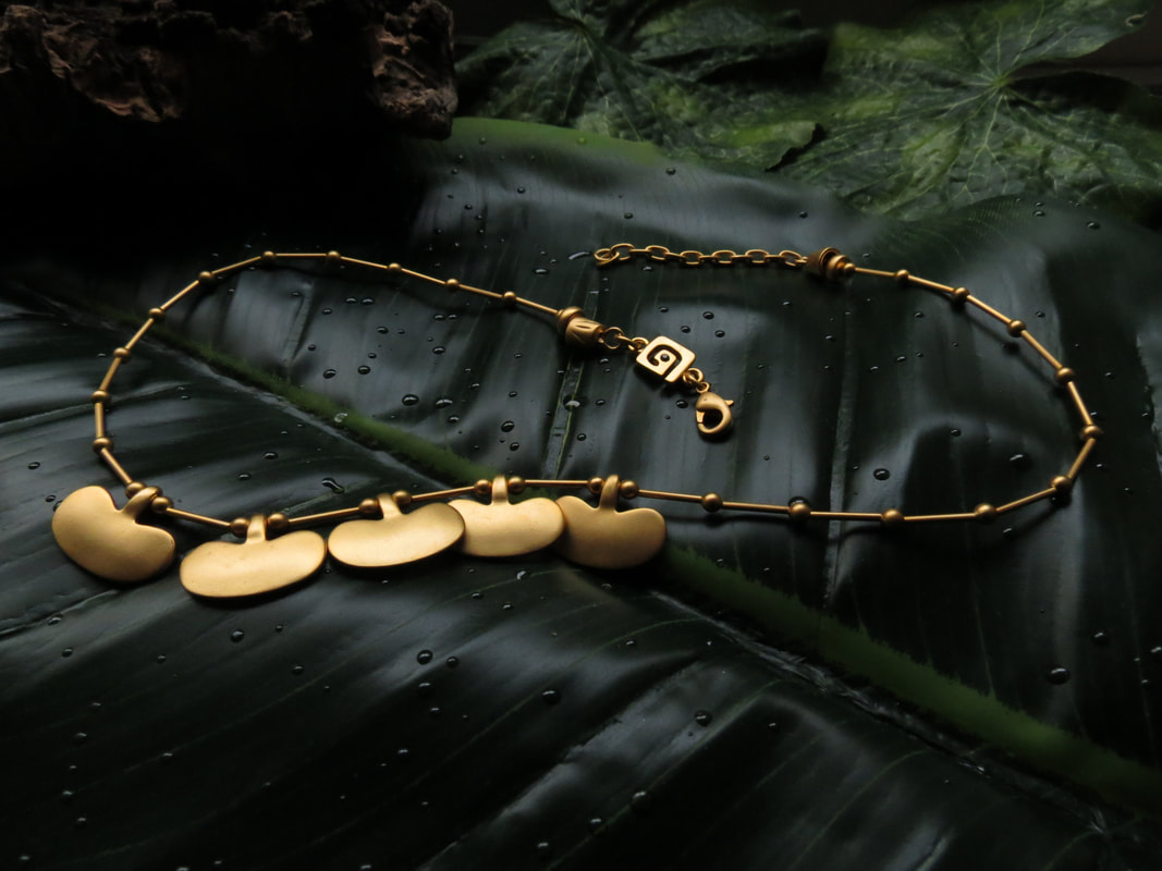 An Elegant And Stylish Necklace Adorned With Gold Beads Rods Pects This